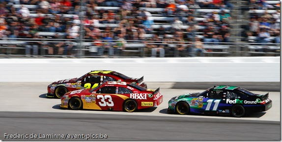 Jeff Gordon (24) lead Clint Bowyer (33) and Denny Hamlin (11) during the Goody's Fast Relief 500 at Martinsville